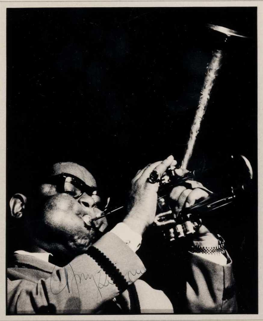 Dizzy Gillespie – With Trademark Bulging Cheeks and Bent Horn